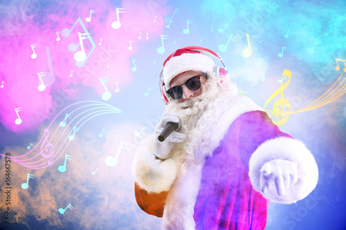 a52f4d3197f3a Santa Claus singing songs on blurred lights background. Christmas and New  Year music