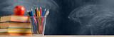 Fototapeta Uliczki - Back to School. Accessories, books and fresh apple against chalkboard