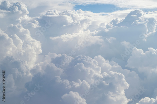 Aerial view from the plane of fluffy rain cloud in daytime - Cloudscape - 164691185