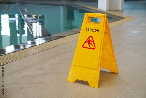 Fotografie, Obraz  caution wet floor warning sign near swimming pool
