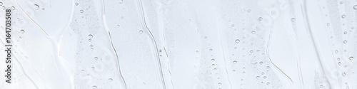 Photo  Fensterscheibe mit abperlendem Wasser als Hintergrund