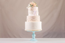 A Large Tiered Wedding Cake In...