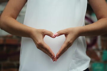 Young woman's hands shows heart. Gesture.