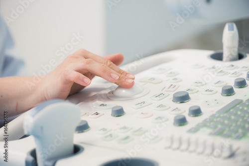 Fotografia, Obraz  young woman doctor's hands close up preparing for an ultrasound device scan