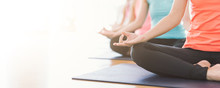 Attractive Young Asian Woman Group Exercising And Sitting In Yoga Lotus Position In Yoga Classes Breath Control With Copy Space