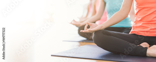 Garden Poster Yoga school Attractive young Asian woman group exercising and sitting in yoga lotus position in yoga classes Breath control with copy space