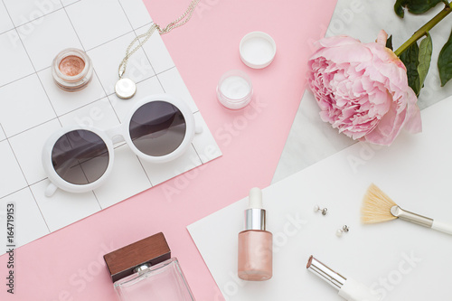 Stampa su Tela Beauty flat lay with cosmetic bottles, phone and flower. Top view