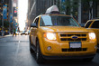 Yellow Cab in Manhattan - New York City. Taxi car in city at sunset.