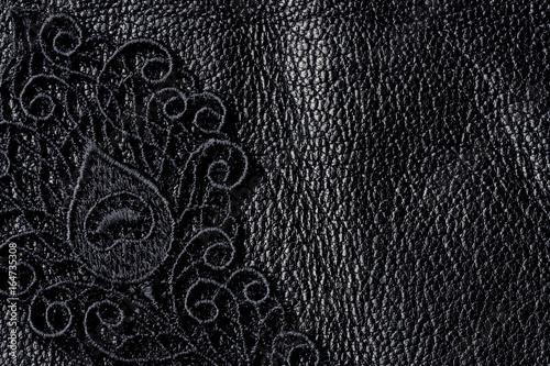 Valokuva  Detail of black lace on leather