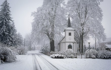 White Chapel Under Snowy Trees...