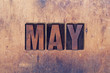 May Theme Letterpress Word on Wood Background