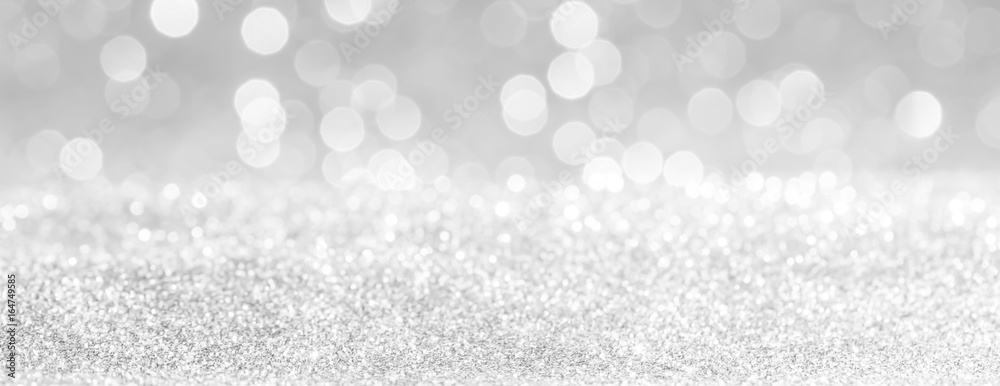 Fototapeta silver and white bokeh lights defocused. glitter  abstract background