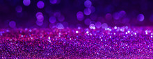 Purple Sparkling Lights Festive Background With Texture. Abstract Christmas Twinkled Bright Bokeh Defocused And Falling Stars. Winter Card Or Invitation.