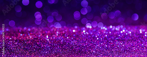Obraz purple Sparkling Lights Festive background with texture. Abstract Christmas twinkled bright bokeh defocused and Falling stars. Winter Card or invitation. - fototapety do salonu