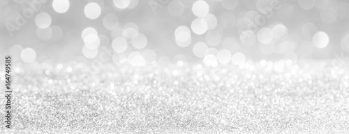 Obraz silver and white bokeh lights defocused. glitter  abstract background - fototapety do salonu