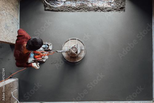 Fotografie, Obraz  concrete floor final grinding, top view