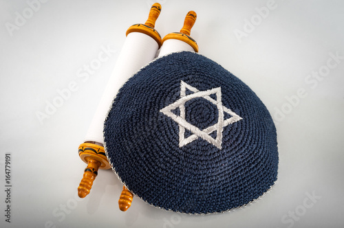 Obraz na plátně  Judaism and jewish religious holiday concept with a closed Torah and a kippah also called a yamaka