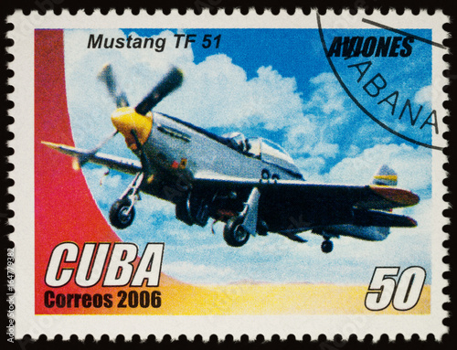 Photographie  Old American military aircraft Mustang TF51 on postage stamp