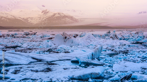sun light reflecting on iceberg glacier lagoon, jokulsarlon of Iceland Wallpaper Mural
