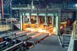 Leinwandbild Motiv hot steel on conveyor in steel plant