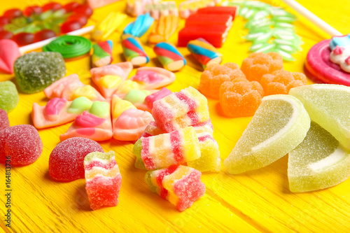 Aluminium Prints Candy Composition of delicious candies on yellow wooden table