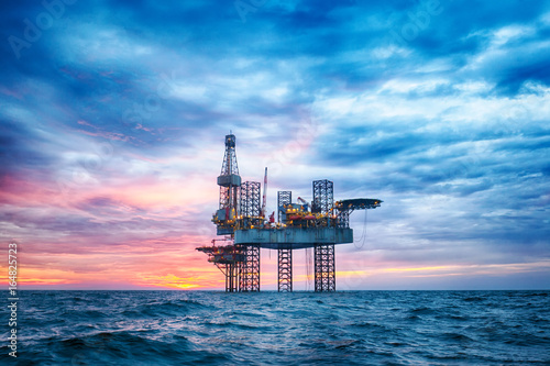 Fototapeta HDR of Offshore Jack Up Rig in The Middle of The Sea at Sunset Time  obraz