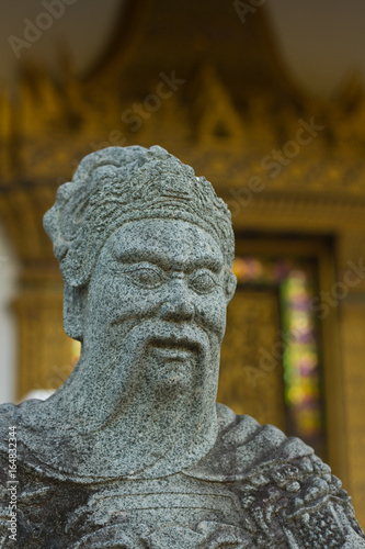 Fototapeta Laoshan,China 21/04/2016 Two stone sculptures discussing and sitting at a table,