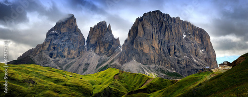 Fotografie, Tablou  Sassolungo & Sassopiatto mountain ranges as seen from Passo Sella on a cloudy af