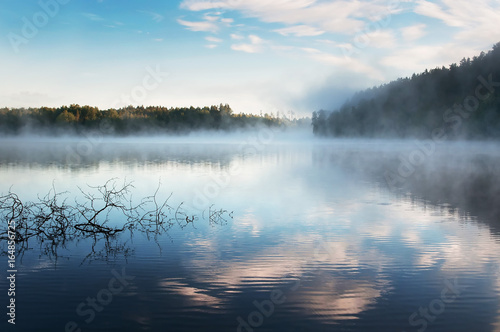 Sunrise mist on Karelia lake. Russia Fototapet