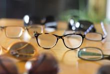 Stylish Eyeglasses On Table