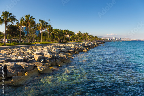 Foto auf Gartenposter Stadt am Wasser Promenade street and pier in the city Limassol, begin of the summer season. Cyprus