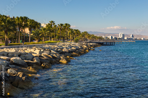 City on the water Promenade street and pier in the city Limassol, begin of the summer season. Cyprus
