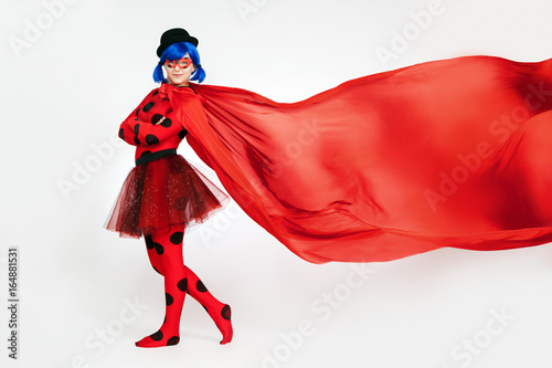 Photo  The girl with a red cape