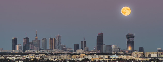 Panorama of rising moon over Warsaw city, Poland