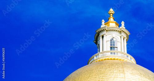 Fotografie, Obraz  Golden dome of Massachusetts State House under blue sky