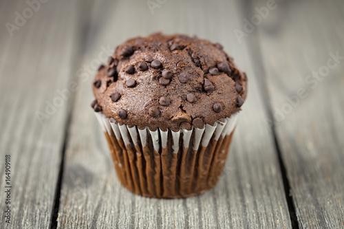 Fotografie, Obraz  Chocolate Chip Muffin on Rustic Wooden Board