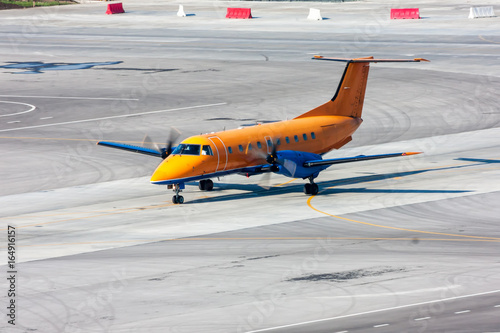 Fotografia, Obraz  Taxiing turboprop airplane at the airport apron