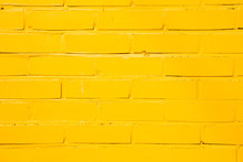 Yellow Painted Brick Wall Background