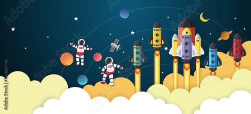 Astronaut cartoon with a spaceship in space,paper cut © panitialapon