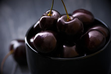 Cherries In Black Bowl