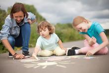 Babysitter Or Kindergarten Concept. Children Drawing With Colo Chalk.