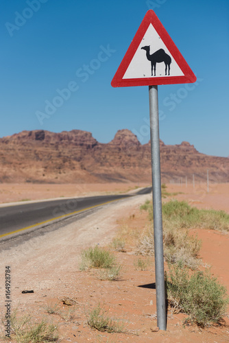 Fotobehang Midden Oosten Road sign in the Wadi Rum desert, Jordan