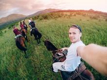 Male Rider On Horseback Holds ...