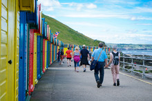 Whitby, North Yorkshire, England - July 1, 2017:,UK - Row Of Colorful Beach Huts At Whitby Beach On A Beautiful Sunny Day In The Summer