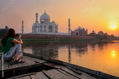 Fotografie, Obraz  Woman watching sunset over Taj Mahal from a boat, Agra, India