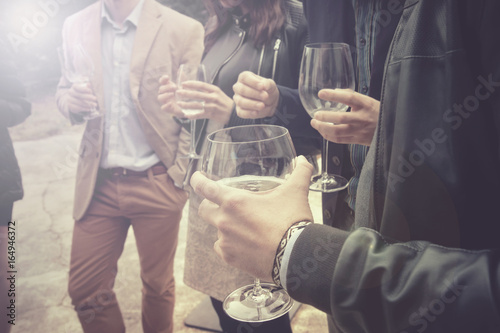 Fotografia, Obraz group of friends drinking wine, people is socializing and having a fun (this ver