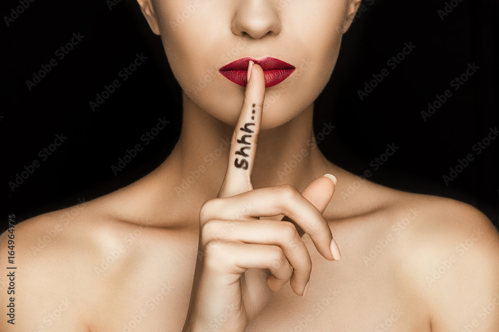 Fototapeta cropped view of seductive woman with red lips showing shh symbol, isolated on black