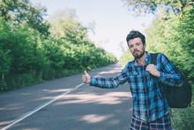 Man Hitchhiking On Road