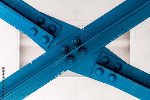 Fotografie, Obraz  Blue construction beam forming an X