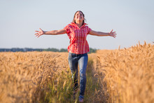 Young Girl Running On Ripe Wheat Field